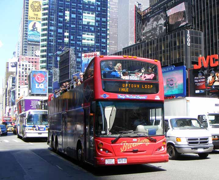 By one of the many rts style buses in the new york city fleet